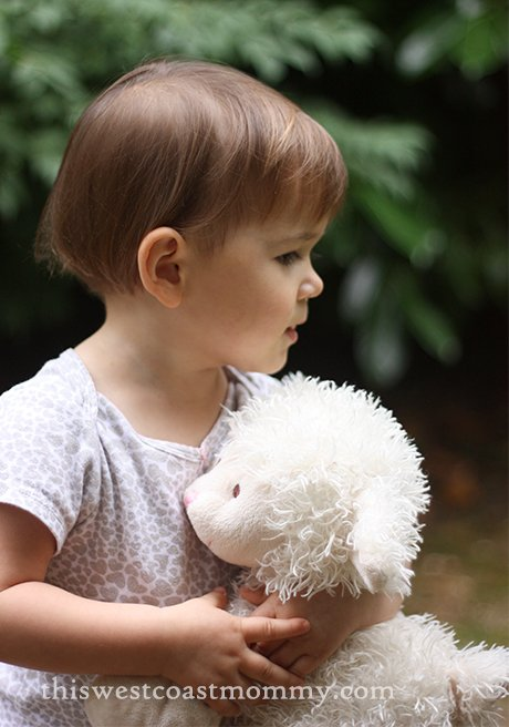 hugging her lamb