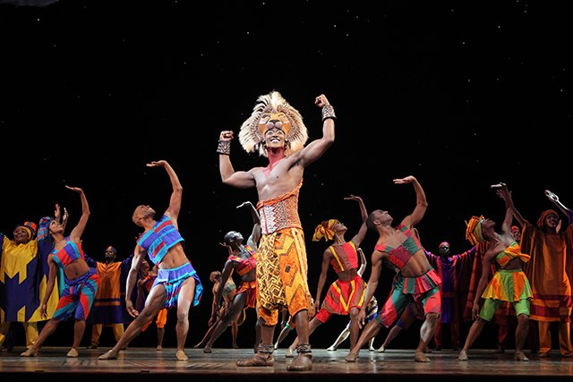 "Jelani Remy as ""Simba"" and the ensemble in ""He Lives in You"" from THE LION KING National Tour. © Disney. Photo Credit: Joan Marcus."