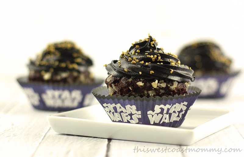 These Star Wars inspired birthday cupcakes are made with gluten-free chocolate cake mix, macadamia nut crumbs, black buttercream frosting, and gold sprinkles.