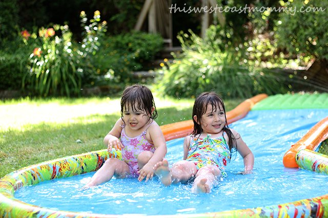 The Slide & Surf water slide is just about the most fun the kids will have in the backyard all summer!