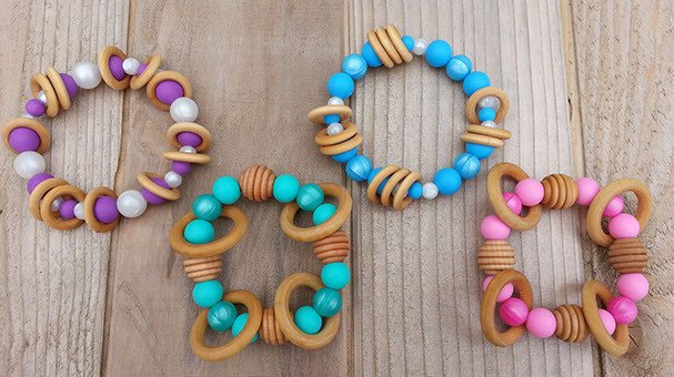 """Between You & Me Teething makes beautiful handmade wood and silicone jewelry is inspired by babywearing and the changing seasons. Safe for babies, this nature-inspired """"chewelry"""" does double duty as a chic necklace or bracelet for you and a soothing teether for your baby."""