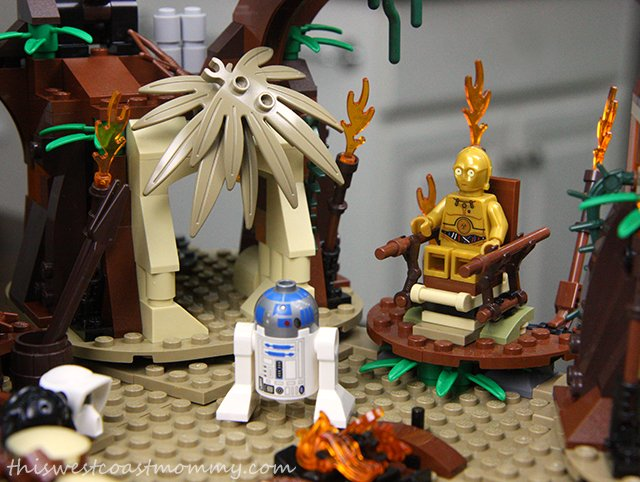 Here's C-3PO on his elevating throne, being worshipped by the Ewoks while his best friend R2-D2 looks on.