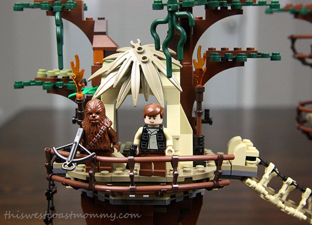 Han Solo and Chewbacca keep watch from up in the trees.