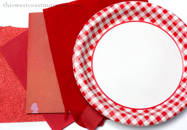 Make a pretty poppy wreath for Remembrance Day with a paper plate and scrap fabrics and papers.